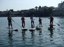 Paddle surfing sunset Cascais